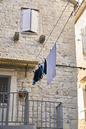 clothes hanged on the street