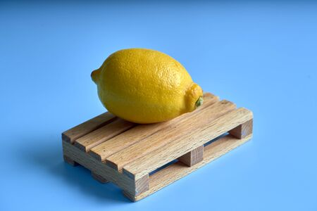 Fresh lemon isolated in blue background