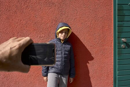 Child making a photo at his friend Imagens
