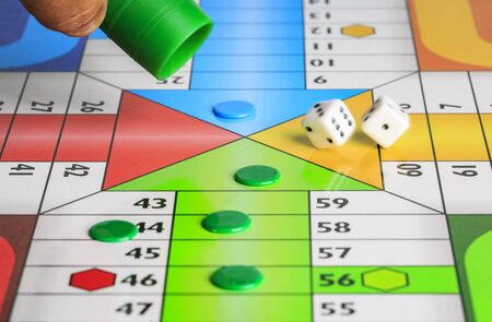 Typical spanish board game parchis Stockfoto