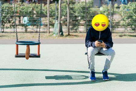 Emoji head man using a smartphone