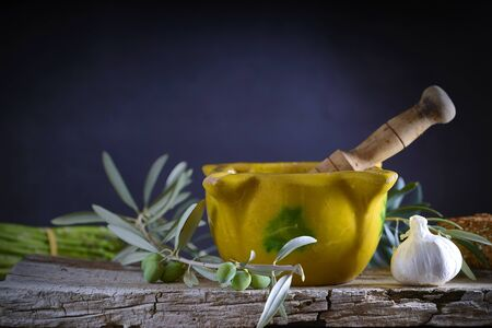 Yellow mortar to make a sauce called allioli, typical of Catalonia. Spain.