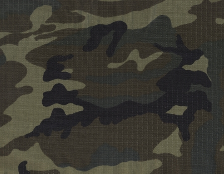 Army green woodland camouflage fabric texture background in high definition