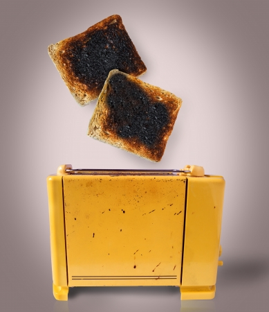Burnt toast popping out of a chaotic toaster Stock Photo