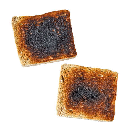 burnt toast: Burnt toast isolated on a white background