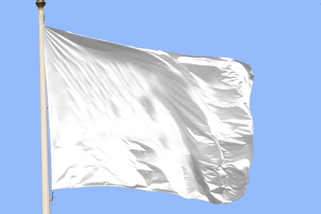 White flag waving on the wind in a blue sky