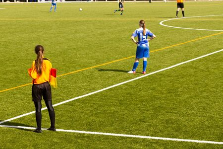 offside: Female soccer referee during a match