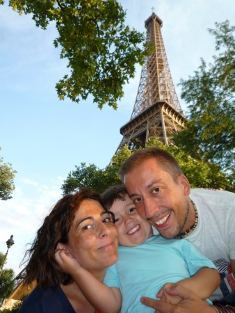 Happy family in Paris holidays  Eiffel Tower photo