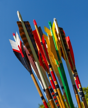 Colorful arrows for target archery against blue sky photo