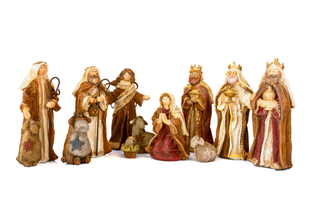 Nativity scene with hand-colored figures on a white background photo