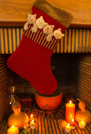 Red Christmas sock hanging in a chimney photo