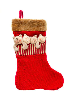 Red Christmas sock isolated on a white background photo