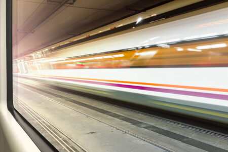 streamlined: Streamlined train with motion blur moves in tunnel seen from another train