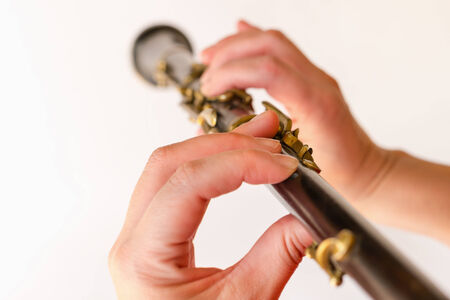 oboe: Detail of oboe being played by a musician