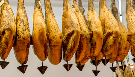 Iberian ham (jamon iberico) typical of Spain, ready to be sold. Stock Photo