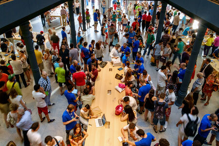 MADRID, SPAIN - JUNE 21 - People inside and outside the Apple store  New Apple Retail Store Opening in Sol square, in Madrid, Spain, on June 21, 2014 Editorial