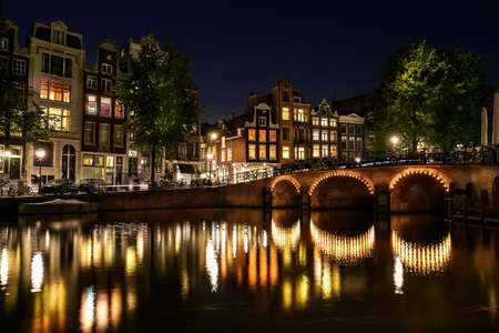 Night view of a canal in Amsterdam, Netherlands photo