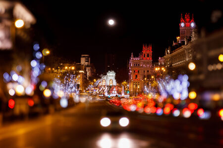 moon  metropolis: Madrid at Christmas. Rays of traffic lights on Cibeles square, Cibeles fountain in front of the The City Hall or the former Palace of Communications in Madrid, Spain. Editorial