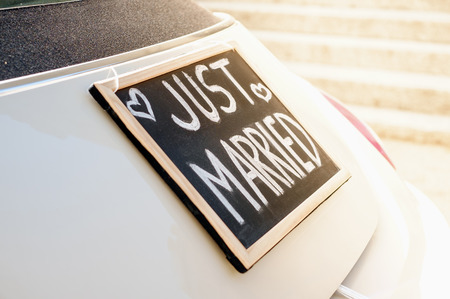 Wedding car with just married sign in a blackboard