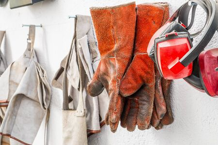industrial safety: Protective clothing for welding, helmet and gloves