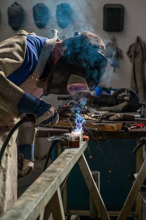 Welder in workshop manufacturing metal construction Stock Photo