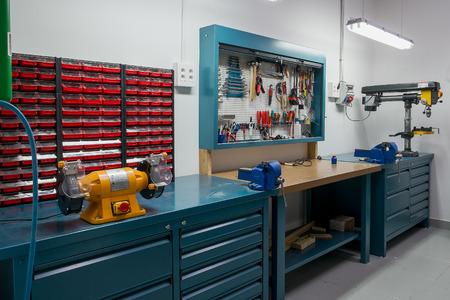 Tools in the board and in workshop. Workshop scene Foto de archivo