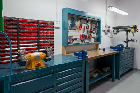 scene: Tools in the board and in workshop. Workshop scene Stock Photo
