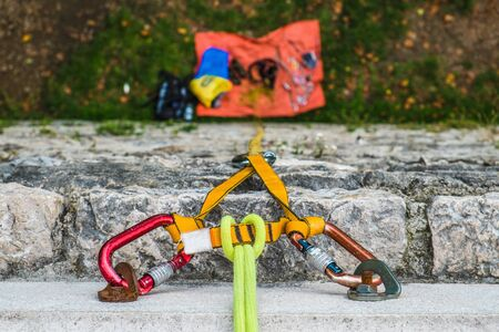 Close-up of a rock climbing rope with hooks on rock