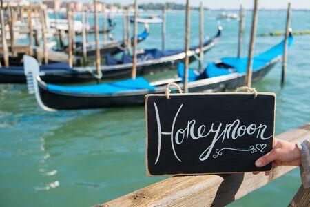 Romantic Honeymoon sign with the gondolas in Venice