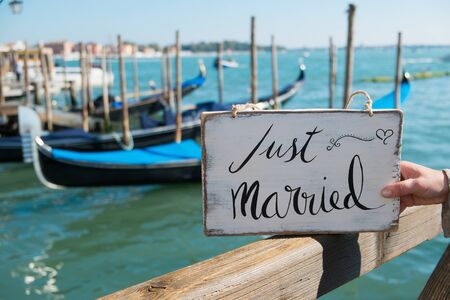 Romantic Just married sign with the gondolas in Venice