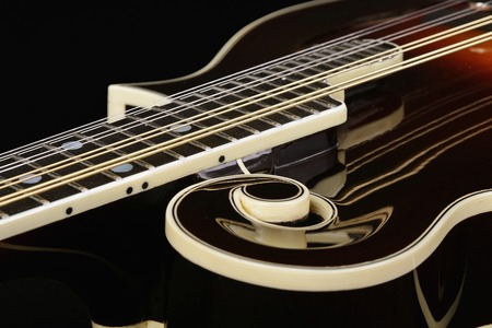 Mandolin era isolated on black background photo