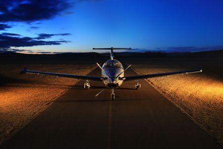 turboprop: Single turboprop aircraft on the groun, night Stock Photo