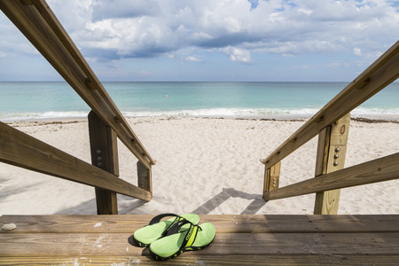 Green beach chairs and blue summer beach house, Florida Stock Photo