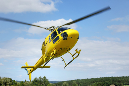 helicopter rescue: Helicopter rescue, helicopter in the air while flying.