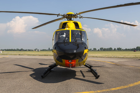 helicopter pilot: rescue yellow  helicopter on the ground in airport Stock Photo