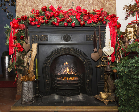 stone  fireplace: Christmas Stone fireplace with decorations, red and green Czech republic