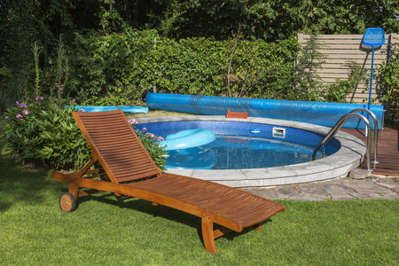 loungers: Home pool on the garden  and wooden sun loungers