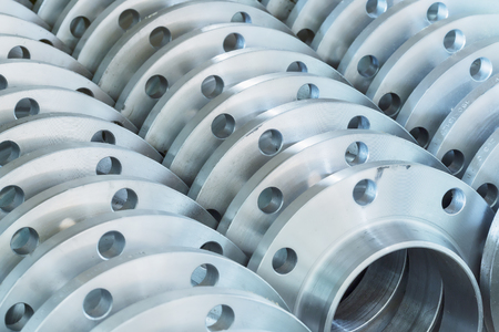 flanges: Flanges stacked in warehouse Stock Photo