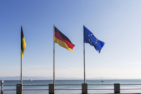 friedrichshafen: Flags of Germany and Europe at Lake Constance in Friedrichshafen harbor. Stock Photo