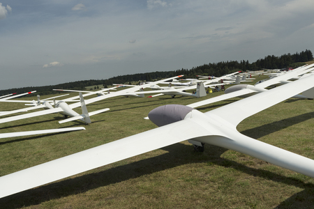 airfield: gliders at green airfield with blue sky