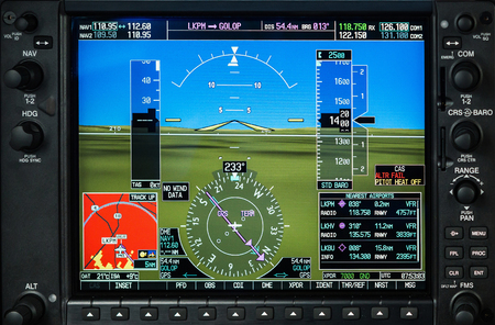 Computer in cockpit. Airplane glass cockpit display with weather radar and engine gauges  in small private airplane Фото со стока