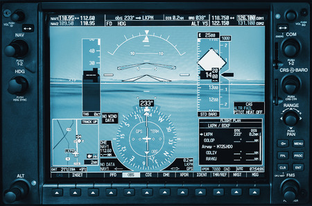 private airplane: Computer in cockpit. Airplane glass cockpit display with weather radar and engine gauges  in small private airplane Stock Photo