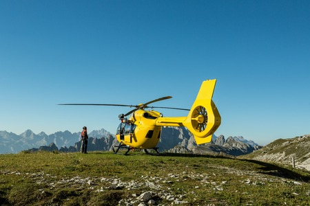 helicopter rescue: Yellow helicopter used for rescue operations, On the ground in Dolomites, Italy. Helicopter rescue