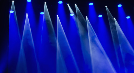 limelight: Stage lights on a console, smoke, image of stage lighting effects
