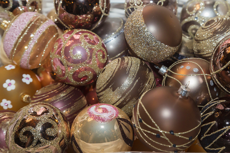 creche: Christmas balls, traditional decorations for Christmas tree, gold brown combination, Czech republic