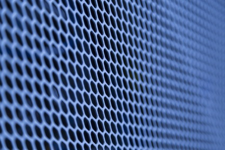 metal grate: Blue metal grille on PC with selective focus Stock Photo