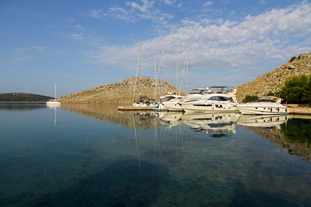 kornati national park: Magnificent azure sea and the bay with the parking luxury yachts in National Park Kornati, Croatia