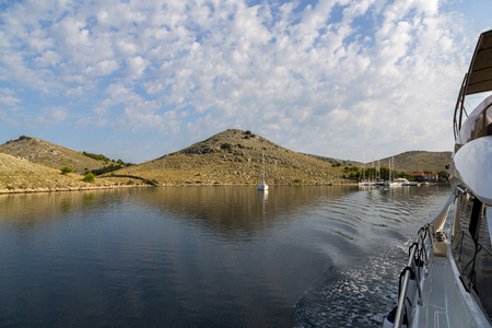 Magnificent azure sea and the bay with the parking luxury yachts in National Park Kornati, Croatia