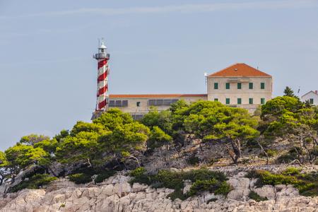 kornati national park: Beautifull island with lighthouse in National Park Kornati, blue sky with clouds, Croatia