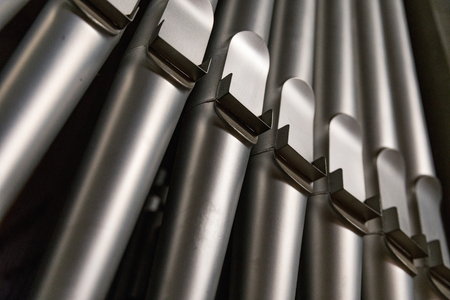 part of the church organ with many air pipes made of metal, detail